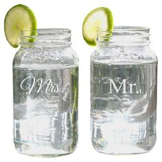 Mason jar with a typographic motif.    Product: Set of 2 mason jarsConstruction Material: GlassColo...