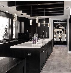34 Admirable Luxury Kitchen Design Ideas You Will Love - When choosing the right luxury home plan, many to-be homeowners often get hung up on the kitchen details. Should there be a separate breakfast nook? Black Kitchen Cabinets, Kitchen Cabinet Design, Black Kitchens, Interior Design Kitchen, Home Kitchens, Dark Cabinets, Interior Decorating, Hallway Decorating, Black And Grey Kitchen