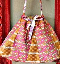 This new drawstring handbag pattern by Bari J. was inspired by her Grandmother's bag and is reversible!