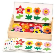 Flower matching game - this is for sale, but I think I could make this using my Cricut & felt or laminated cardstock (I'd use Velcro to hold on the laminated cs) ~ Am