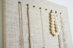 Burlap jewelry board. Finally a way to make the massive mess of jewelry look awesome! So many fabric options!