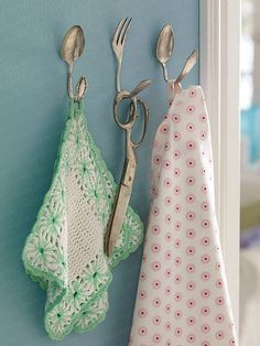 Grab some vintage flatware, bend and hang, great kitchen hooks