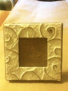 Cornice in carta fatta a mano e spago