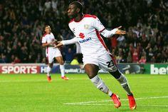 Benik Afobe celebrates scoring the third goal for MK Dons