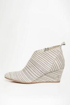 thin striped wedge booties; minimalism, minimalist fashion; accessories