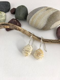 Beige Puget Sound Pebble Earrings,  Beach Pebble Earrings with sterling ear wires that are handmade and sterling wire detailing. See them and more at: www.etsy.com/shop/AndiClarkeJewelry