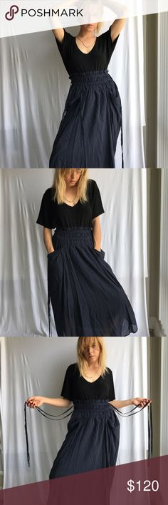 Malia Mills High Waisted Navy Blue Skirt w Ties Beautiful Malia Mills Brand Skirt, size 6, waist stretches, has ties, high - low bottom, front of skirt falls 32 inches back falls 42 inches. Has pockets, high waisted. Dreamy, thin fabric, soft. In excellent condition. Malia Mills Skirts High Low