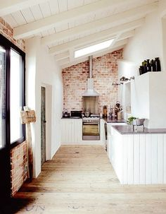 light kitchen with exposed brick