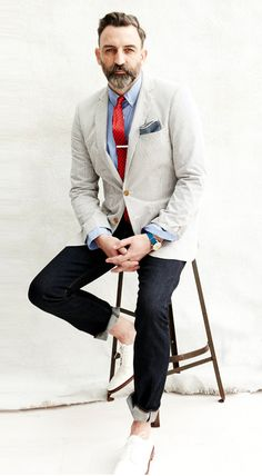 This man knows what he's doing. Great use of color. Love the contrast between jacket and pants. Love the crisp, white shoes, love that blue and red. Great style. Great for spring/summer.