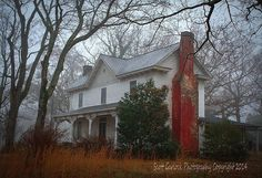 """Winter Flames"" Painted in autumn orange, dry grasses...like the flames of a wild fire.. blaze across frozen ground lapping at the foot of history burning through the frozen mist of a winter morn. (2014)  Photographer's Notes - Under a bare canopy of winter oaks, this old Civil War era homestead in Warren County, NC with it's red chimney emerges from an early morning winter fog."