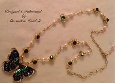 """""""Emmeraude"""": Love the artisan crafted links and components in this 28"""" Emerald green crystal and Pearl butterfly pendant & 18 Kt gold overlay chain by Alexandra Marshall. Available in your choice of Swarovski colors and pendant designs. Price available upon request (item #C1929)"""