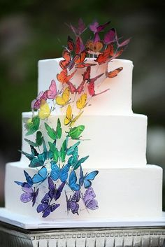 Rainbow Butterfly Wedding Cake! http://offbeatbride.com/california-rainbow-wedding