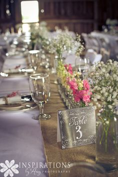 Vintage barn wedding tablescape featuring spring flowers in pink and white color palette.  Flowers by Buckeye Blooms    Photo by Inspirations by Amy