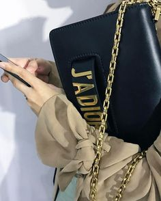WEBSTA @ bagaholicboy - Maria Grazia Chiuri's bag-of-the-season, simply known as the Flap Bag with the J'ADIOR (or I love Dior) emblazoned across it. Love.