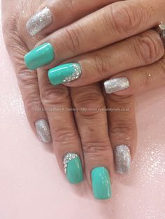 Jades a gem gel polish with silver glitter and swarovski crystals Taken at:6/17/2014 11:40:46 AM Uploaded at:6/17/2014 9:39:38 PM Technician:Elaine Moore