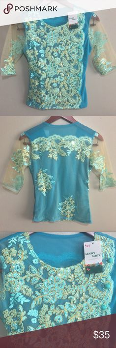 NWT Embellished Blouse This is so beautiful! The sleeves are sheer and the back is semi sheer. Covered with elegant embroidery and sequins. Size is small to XS. Measurements will be added. Tops