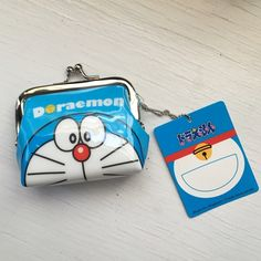 Doraemon change purse from Japan Small Doraemon change purse from Japan. Measures about 3 1/4 inches across and 3 inches from closure to base. Reasonable offer accepted. Bags