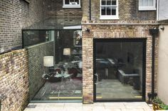 Pivot Door and Frameless Glass Box Extension : Modern houses by Culmax