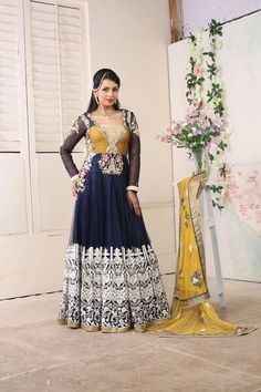 Aishwarya design studio presents this blue and yellow colored long Indian Designer anarkali suit, which will make you look striking and even more beautiful. Ghera portion of anarkali salwar suit is engrafted with resham embroidery all over.