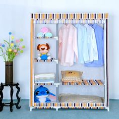 Simple Orange Striped Pattern Folding Wardrobe Design With Doll Shelves Idea Along With Flower Vase The Top Table In The Nearby Including Soft Blue Painting Wall Fantastic Folding Wardrobe Design Furniture