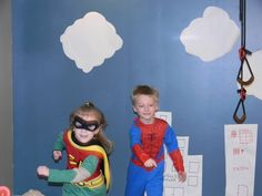 Taped a paper city to the wall, had the kids dress in their super hero costumes, then took pictures to make comic books.