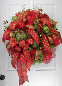 A glamorous deco mesh wreath with lots of dots and glitz. Two high quality deco…