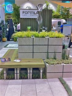 Great cinder block planter and bench!  Possibly painted and put by the downstairs patio?  grass growing on the top!