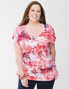 Printed sequin stripes add just the right touch of sparkle to our floral sublimation tee. You'll love how it flatters your curves with its charming scoop neckline and drawstring shirred sides. Feminine and fun, this colorful tee is a perfect choice for the season in a fashionable longer length to complement leggings or capris perfectly. lanebryant.com