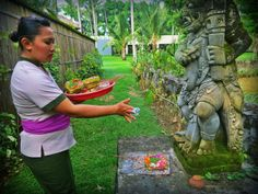 """Daily Offering – at Cuca  The Balinese are extremely devout and no day goes by without making offerings to the gods. These daily offerings, called """"Canang,"""" are seen nearly everywhere in Bali. They are made of flowers, cookies, rice and even sometimes money or cigarettes. Canang are given to the good spirits in hopes of continued prosperity as well as to the evil spirits as an appeasement."""