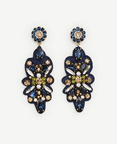 "Set on satiny ribbon, our jewel-toned floral earrings make a style statement that truly blooms. Post back. 3 1/4"" drop."