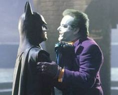 """Batman: """"Excuse me. Have you ever danced with the devil in the pale moonlight?""""[Batman punches Joker]"""