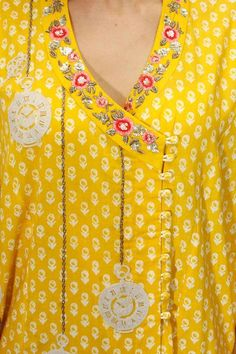Anju Modi presents Yellow floral embroidered angrakha kurta and palazzos set available only at Pernia's Pop Up Shop. Neck Designs For Suits, Neckline Designs, Dress Neck Designs, Blouse Designs, Kurta Patterns, Dress Patterns, Salwar Kameez, Kurta Neck Design, Kurti Neck