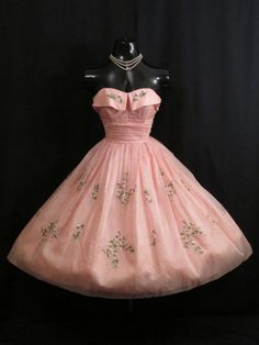 Description    An exquisite original 1950's party/prom dress in a stunning baby pink silk organza decorated with embroidered floral bouquets. The