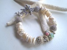 SEA URCHIN - A Lampwork, Keishi Pearl and Sterling Silver Bracelet - LOVE the seashells!!