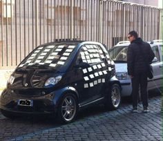 Trastevere Roma ,walking on the street,  love messages on the car