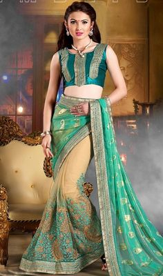 Plunge into elegance wearing this rama green and beige georgette net half n half sari. Beautified & stylized with lace and resham work. Upon request we can make round front/back neck and short 6 inches sleeves regular saree blouse also. #RamaGreenAndCreamGeorgetteAndNetSari