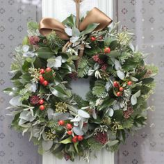 Rose Hips & Pine Door Wreath combines rose hips with pine with additional herbs and foliage finished with a beautiful green ribbon to tie to your door. This door wreath will measure around 14 inches diameter. If you are decorating your home for Christmas you may also wish to select the matching table wreath, bouquet and fireplace/staircase garland t…