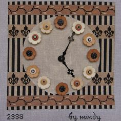 Buttoning Time, a needlepoint clock design by Mindy.