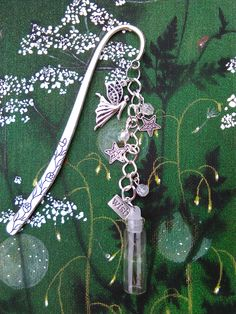 """large fairy bookmark with real dandelion seeds in a glass bottle, ideal for """"End of term Teacher Presents."""