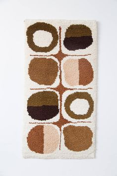This is a wonderful latch hook wall tapestry. - Very soft pallet - Handmade - Wonderful space age mid century modern minimalist design - Excellent condition - Made circa 1960s in Canada - Nice browns and creamy colours - Classic boho eclectic style Measurements: Measures 28x52 inches Condition: Great condition. No bad smells. See photos. Shipping: Price includes tracking in Canada and USA. Items purchased from the USA are shipped from Niagara Falls, New York with USPS. Items bought in Can...