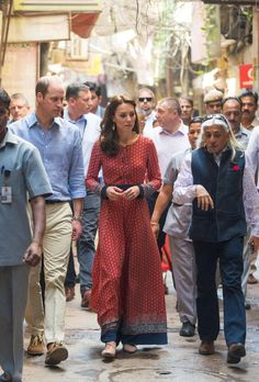 Catherine, Duchess of Cambridge and Prince William, Duke of Cambridge, take a tour of a contact center for homeless children while visiting New Delhi on April 12, 2016. Kate donned an afforadable maxi dress from the website Glamorous, that apparently sold out quickly due to high demand.