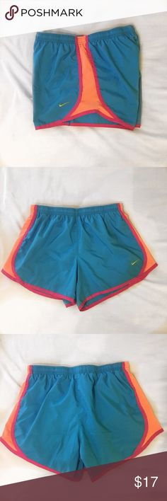 Pink blue & orange Nike shorts Blue Nike shorts with orange sides and pink edges!! In really good condition besides a small stain on the front (pictured). There's also a built in liner :) Nike Bottoms Shorts