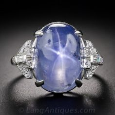 A high-domed 'sugarloaf' cabochon sapphire, weighing approximately 22 carats and displaying a light cornflower blue color and a wispy six-ray star, glows between a pair of sparkling, and distinctively Art Deco diamond-set shoulders, in this stunning and s Bijoux Art Deco, Art Deco Jewelry, Jewelry Rings, Jewlery, Head Jewelry, Crystal Jewelry, Fine Jewelry, Sterling Silver Jewelry, Antique Jewelry