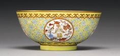 A FAMILLE-ROSE YELLOW GROUND 'MEDALLION' BOWL TONGZHI MARK AND PERIOD decorated with four medallions each enclosing auspicious emblems, the interior with a central medallion, below a band of four floral and fruit reserves alternating with florets, a six-character mark in iron-red, wood stand (2)