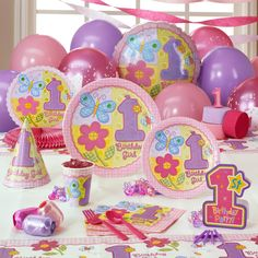 Hugs & Stiches Girl 1st Birthday Deluxe Pack for 8 - I like the lady bug in this set better than the all lady bug party supplies I think... too many choices!