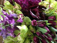 Jewel colours... lilac sweet peas, acid green cymbidium orchids, hyacinths and tulips