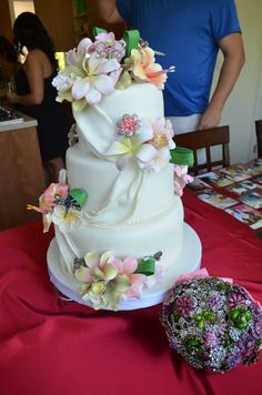 Tropical Themed Wedding Cake with Gumpaste Flowers and Brooch Accents Made by my daughter in law, Nicole!