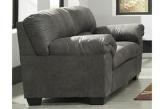 If you love the cool look of leather but long for the warm feel of fabric—you'll find the Bladen loveseat fits the bill beautifully. Rest assured, the textural, multi-tonal upholstery is rich with character and interest—while plush, pillowy cushions merge comfort and support with a high-style design.