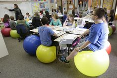 In 11 years of teaching, ditching students' desk chairs in favor of yoga balls is one of the best decisions Robbi Giuliano thinks she ever made.Replacing stationary seats with inflatable bouncers has raised . Classroom Setting, Classroom Design, Classroom Organization, Classroom Management, Classroom Ideas, Classroom Behavior, Behavior Management, Future Classroom, Organizing