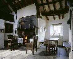 The National Trust's Tintagel Old Post Office, Cornwall, is a delightful medieval building, enhanced by a cottage garden. Irish Cottage, Old Cottage, English Cottage Interiors, Medieval, Old Post Office, Interior And Exterior, Interior Design, Tadelakt, Open Fires